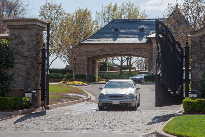 A car coming through the gates at Gaillardia Golf and Country Club.
