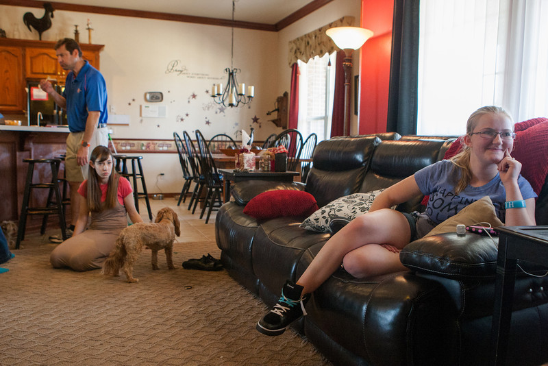 Hope Warfel (right) at home in Midwest City, OK. She is part of the Systems of Care that is facing state budget cuts.