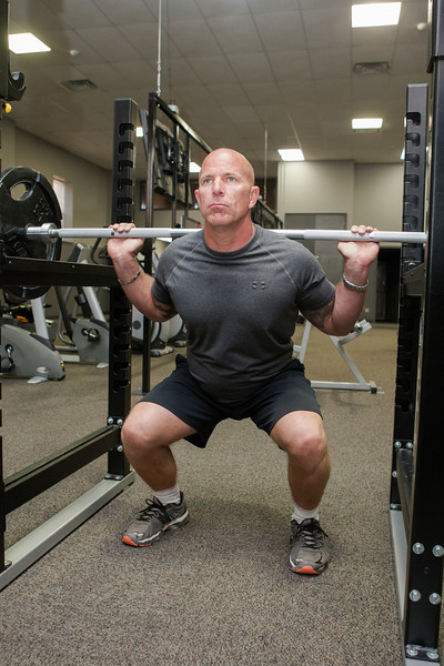 Chad Hane, with the Stillwater Fire Department, works out at the city employee's gym in Stillwater, OK.