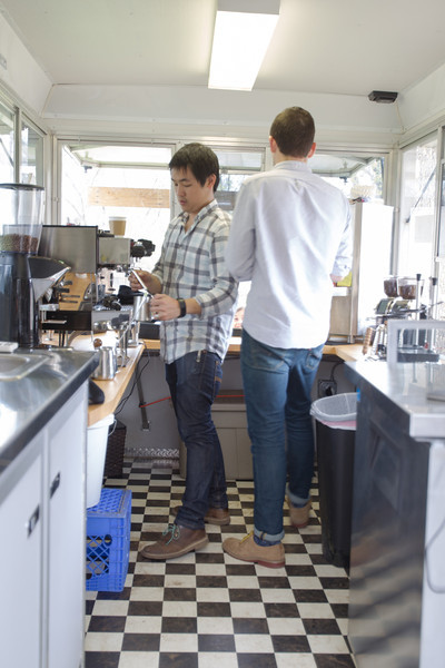 Daniel Koa and Tyler Ford prepare coffee drinks Mariposa Coffee Rosteries mobile coffee truck in Norman, OK.