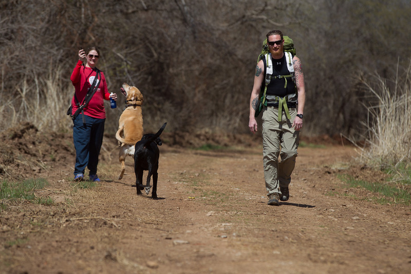 Flynn King walking with his wife Kama and their three dogs preparing for a 165 mile hike through the Ouachita National Forrest.