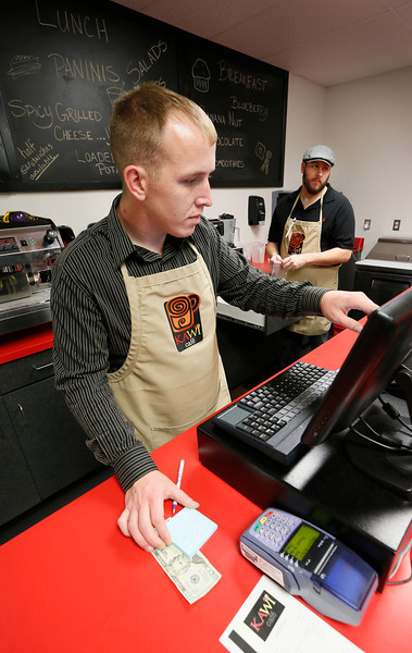 Mike Fuller and Steve Hamby work the counter at the Kawi Cafe in Tahlequah.
