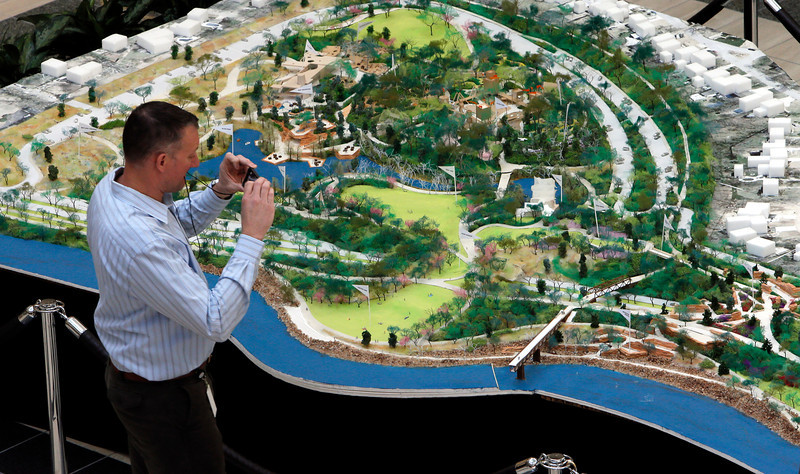 "Alan Mason shoots a photos of the 23' x 10""  scale model of The Gathering Place on display at the Williams Center in downtown Tulsa.  Phase 1 of the 90 acres park along the Arkansas River will be completed in late 2017."