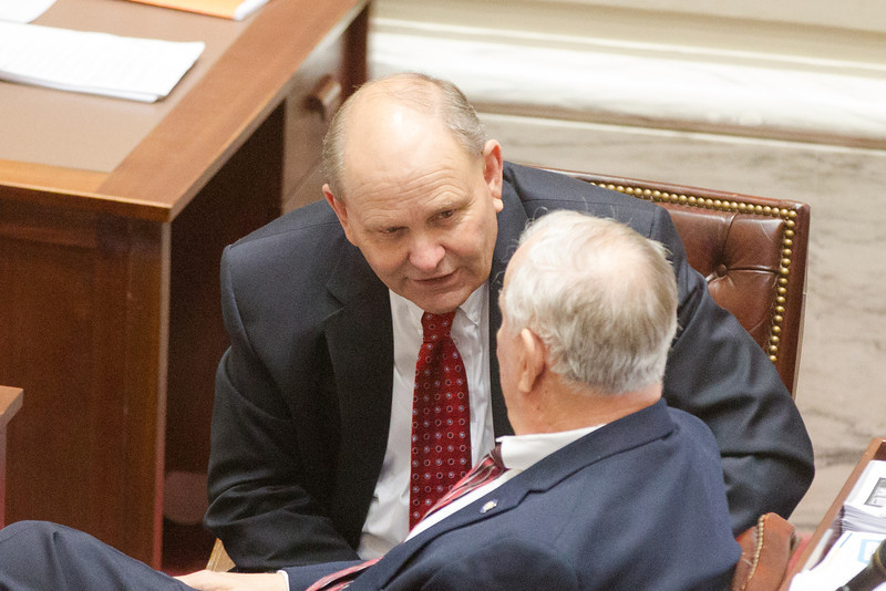 Sen Jerry Ellis speaking with fellow senator Earl Garrison on the floor of the Oklahoma State Senate.