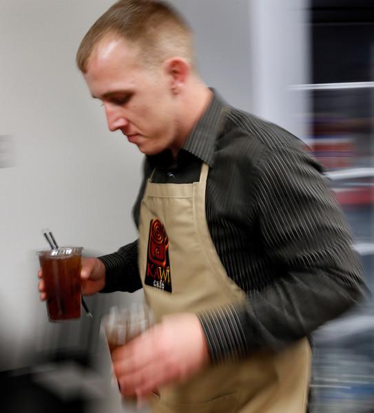 Mike Fuller delivers drinks at the Kawi Cafe in Tahlequah.