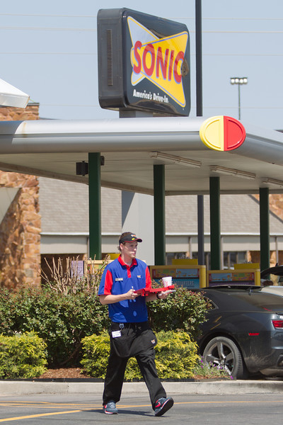 A Sonic car-hop delivering an order in Edmond, OK.
