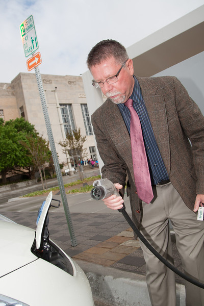 Marty Lawson with a city owned electric fleet vehical that is kept charged on Colcord Drive in downtown Oklahoma City, OK.