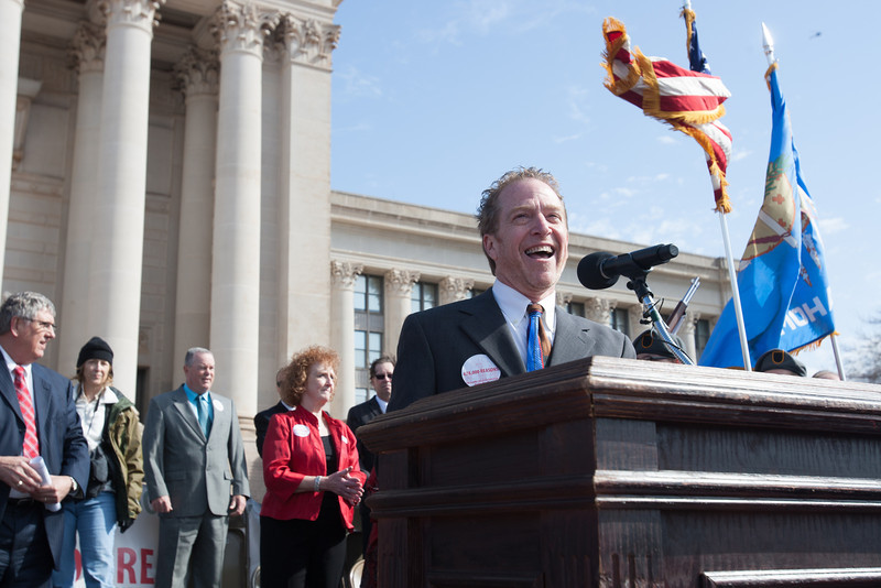 Floyd Cox, with the National Education Association, emceed a rally for education spending at the Oklahoma State Capitol.