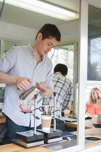 Tyler Ford makes coffee in the Mariposa Coffee Rosteries mobile coffee truck in Norman, OK.