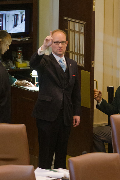 Minoritly leader Scott Inman voting on in the Oklahoma House of Repersenitives.