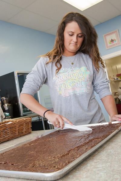 Megan Morris cuts brownies at Cupcake Heavan located at 12317 N Rockwell in Oklahoma CIty, OK.