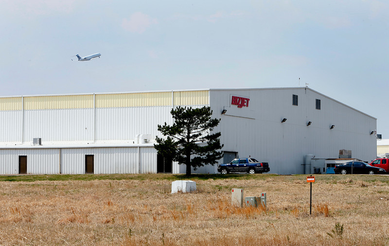 An airliner departs over one of the many Bizjet facilities at the Tulsa International Airport.