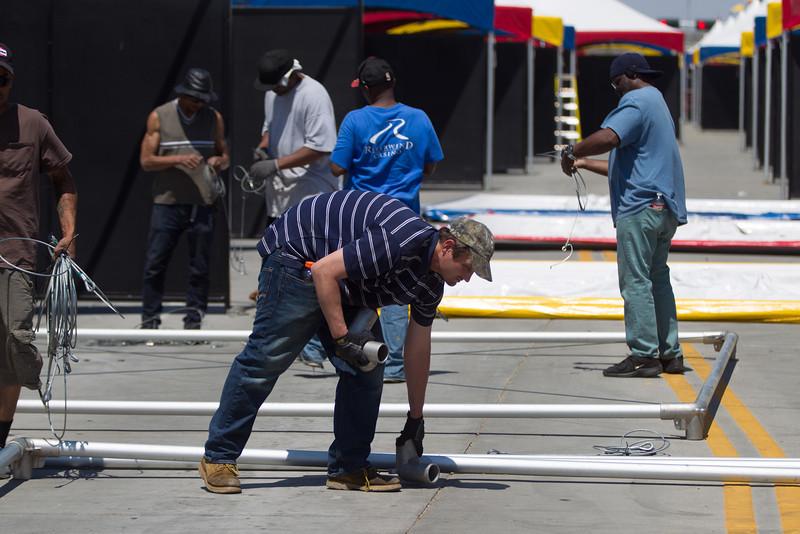 Crews prepare Hudson Ave, adjacent to the Myriad Gardens, for the Oklahoma City Arts festival starting April 22.