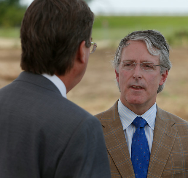 Gary Parkes of Parkes Development LLC and Tulsa Mayor Dewey Bartlett chat before the groundbreaking ceremony at The Walks shopping Center in West Tulsa.