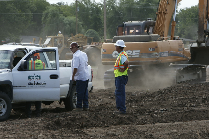 Workmen prepare the site of The Walk shopping Center in West Tulsa.