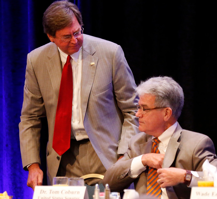 Tulsa Mayor Dewey Bartlett and Oklahoma Senator Tom Coburn chat prior to Coburns presentation at the Congressional Forum Breakfast.