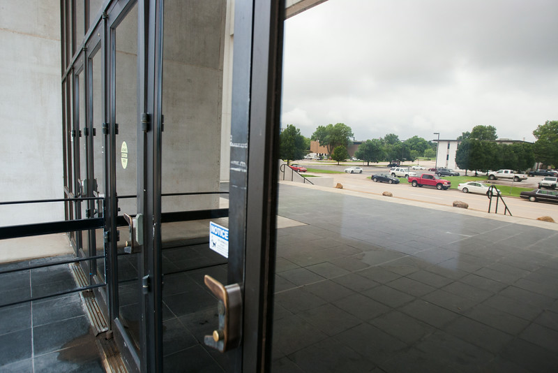 The Oklahoma Worker's Comp Commision placed public notice of it's July 31st meeting behind glass that obscures the visibility of the notice. The back of the notice can been easily seen on the inside.