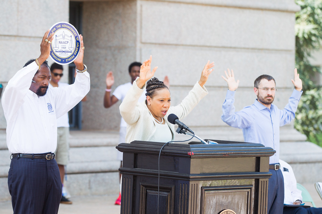 State Repersenitive Anastasia Pittman held a rally at the Oklahoma State Capitol in reaction to  the shooting of an unarmed man by a police officer in Ferguson, MO.