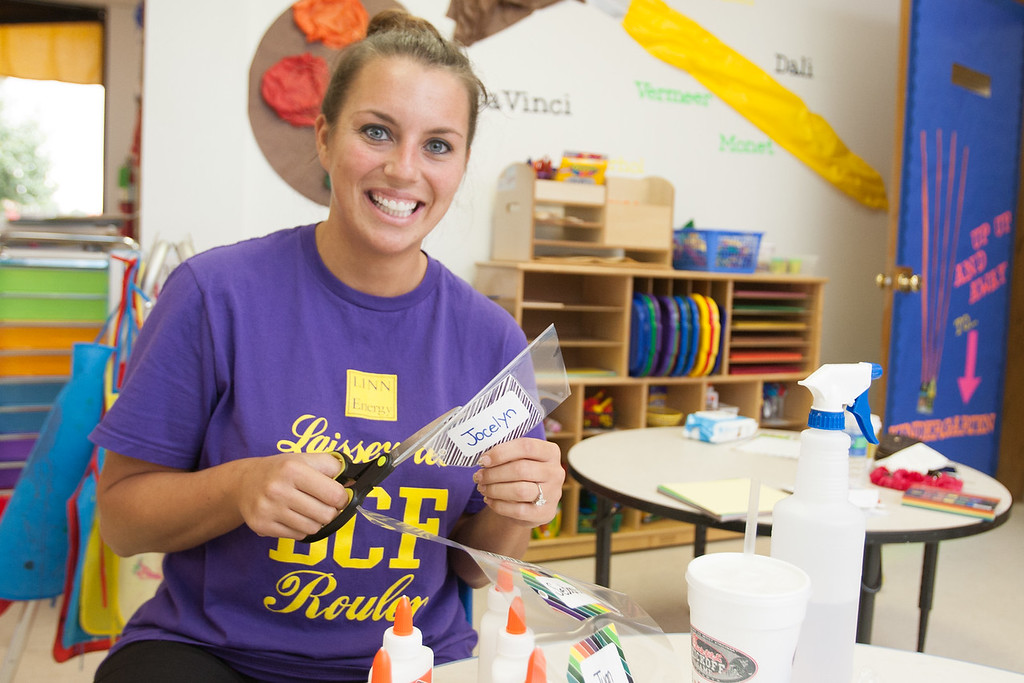 Kindergarten teacher Lyndsey Slaughter getting her classroom ready for the new school year at Celebration Preschool.