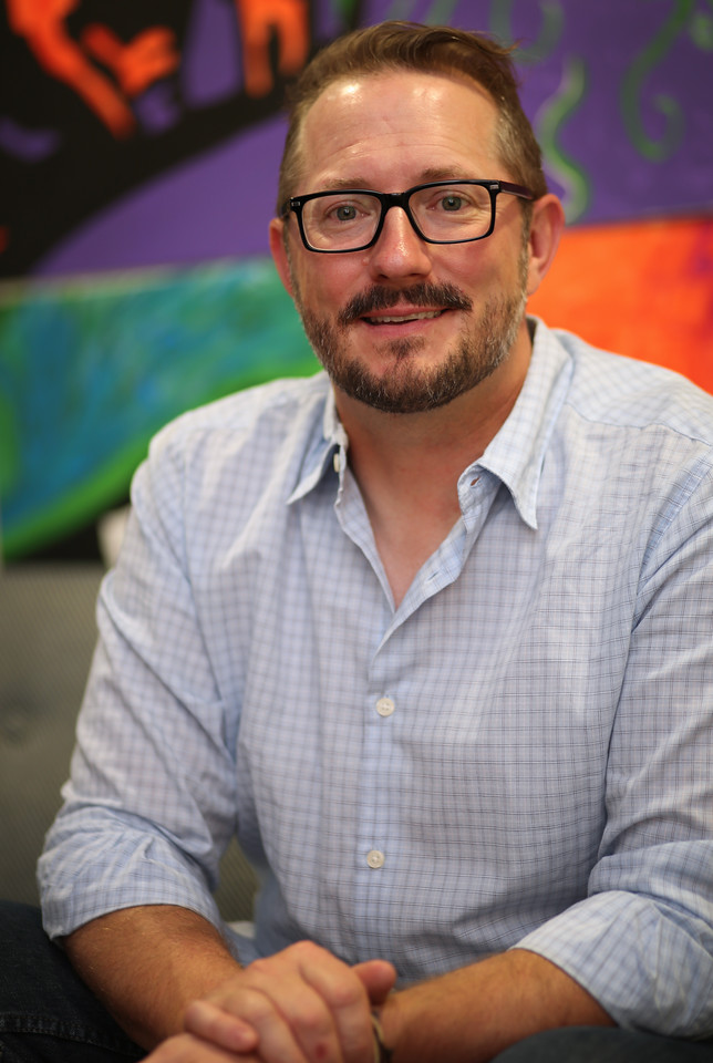 Brady Deaton, CEO and Founder of Idefi, pauses for a photograph at his downtown Tulsa office.