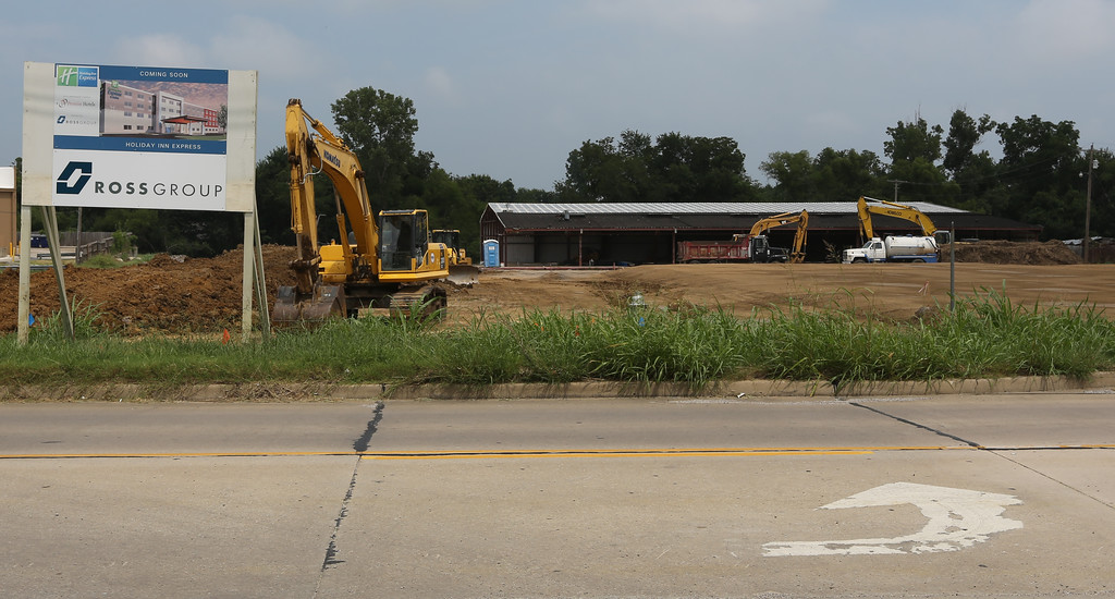 Promise Hotels intends to open a Holiday Inn Express on this Claremore lot in March. General contractor The Ross Group started this work by demolishing and rebuilding part of an old bowling alley to serve as a convention center to the hotel.