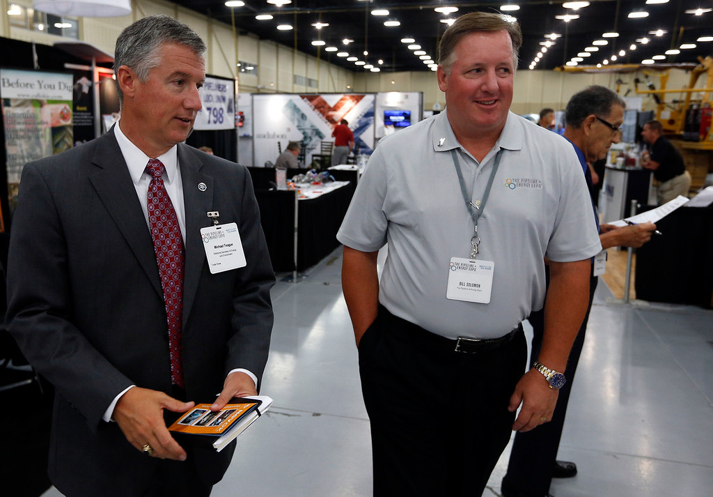 Oklahoma Secretary of Energy and Environment Michael Teague gets a tour of Tulsa's Pipeline and Energy Expo from Vacuworx President Bill Solomon.