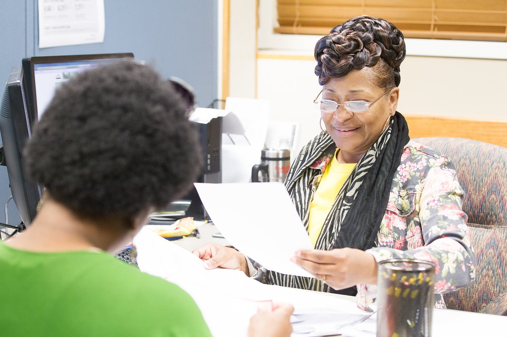 Joy Jefferson help a student apply for finacial aid at the University of Central Oklahoma in Edmond, OK.