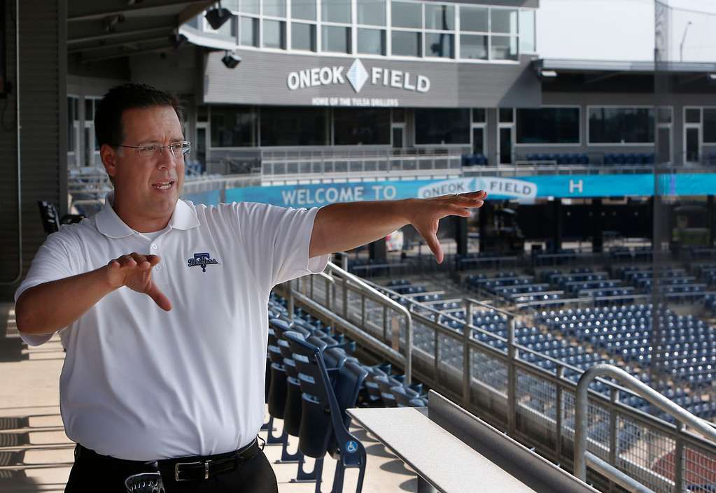 Mike Melega, Tulsa Drillers General Manager, gestures while discussing the seasons attendance numbers.