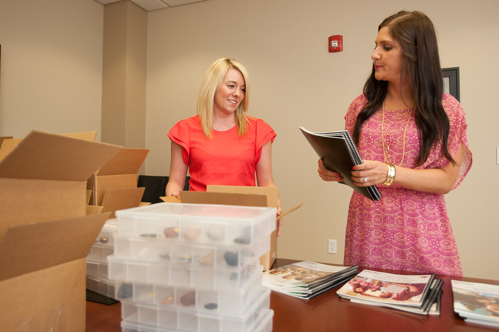 Taylor Todd and  Carla Schaeperkoetter assembling school curriculum packages at Oklahoma Energy Resources Board.