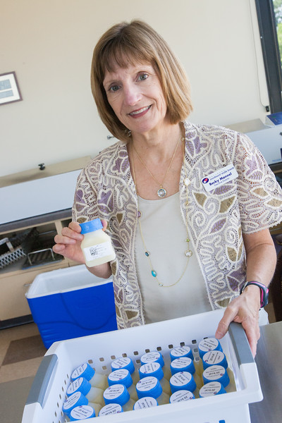 Becky Mannel, Executive Director of Mother's Milk Bank, with a case of frozen pasturized breast milk ready for delivery.