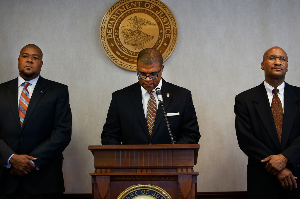 At a news conference in Tulsa Damon Rowe of the Internal Revenue Service, United States Attorney Danny C. Williams Sr. and Special Agent in Charge James E. Finch of the Federal Bureau of Investigation announce charges criminal charges filed against Reverend Willard L. Jones, past pastor of he Greater Cornerstone Community Development Project.