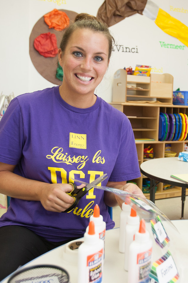 Kindergarten teacher Lyndsey Slaughter getting her classroom ready for the new school year at Celebration Preschool.