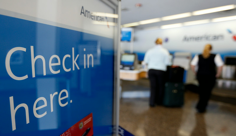 Passengers check in at the American Airlines counter at Tulsa International Airport.  Passenger traffic at Tulsa International Airport  was up more than 13 percent in July compared to last year.