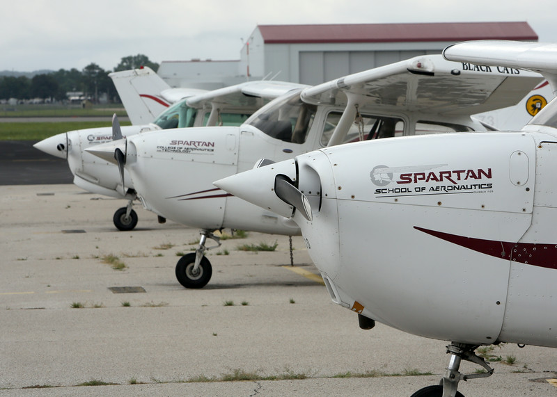 Training aircraft sit on the tarmac at the Spartan School of Aeronautics in Jenks.