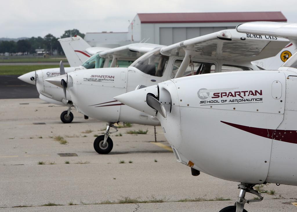 Training aircraft sit on the tarmac at the Spartan School of Aeronautics in Jenks.