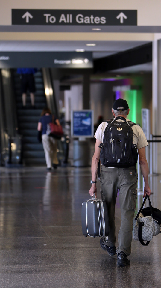 A traveler heads to the gate at Tulsa International Airport.   Passenger traffic at Tulsa International Airport  was up more than 13 percent in July compared to last year.