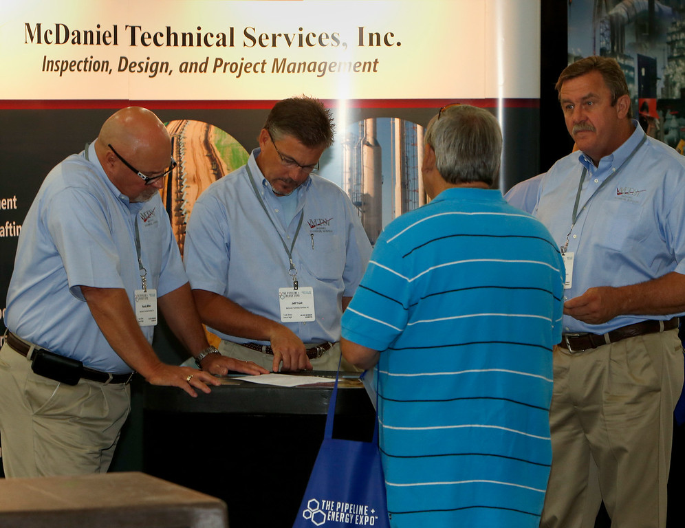 Randy Miller, Jeff Troost and Jim Gerlach of McDaniel Technical Services answer an attendees questions at Tulsa's Pipeline Energy Expo.