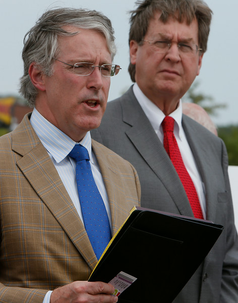 Tulsa Mayor Dewey Bartlett  listens as Gary Parkes of Parkes Development LLC speaks at the groundbreaking ceremony at The Walks shopping Center in West Tulsa.