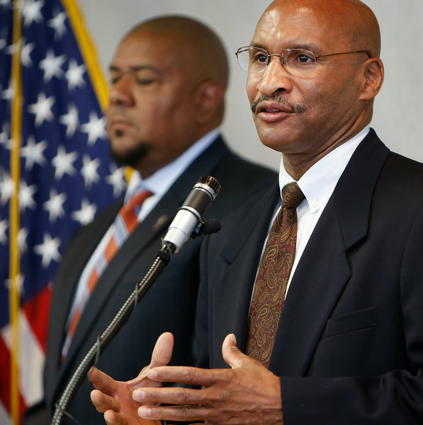 At a news conference in Tulsa Damon Rowe of the Internal Revenue Service and  James E. Finch of the Federal Bureau of Investigation announce charges criminal charges filed against Reverend Willard L. Jones, past pastor of he Greater Cornerstone Community Development Project.