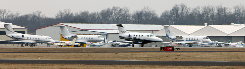 A private jet lands at the Riverside airport in Jenks Tuesday.