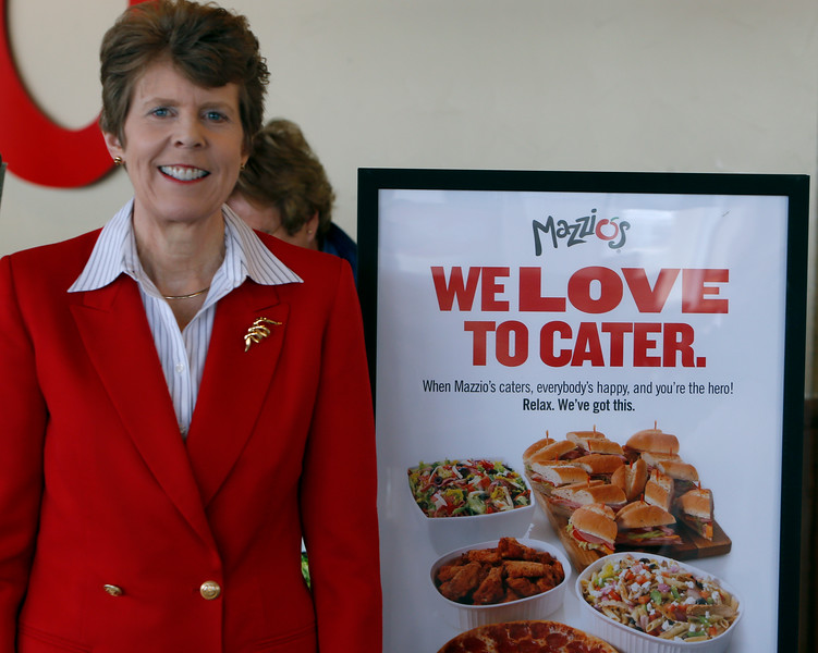 Sheri Miksa, President of Mazzios, pauses for a photo at the companies downtown restaurant.