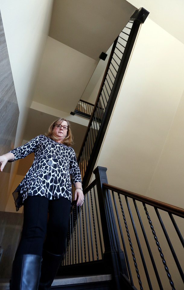 Robbin Jernegan, an oil and gas titles/division order analyst with XXXXXX law firm in Tulsa walks stairs on her lunch hour.<br /> <br /> ***Check with Sarah on Employer***