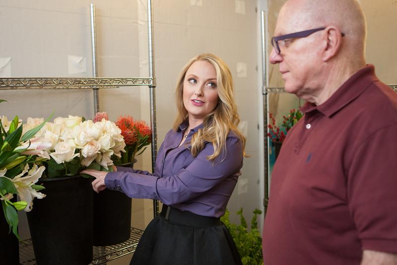 Wedding planner Allyson VinZant working with florist Tony Foss.