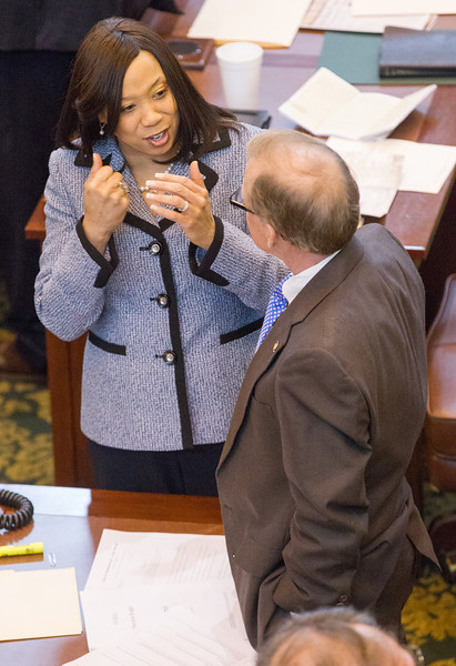 Rep Anastasia Pittman talks to Rep Earl Sears on the floor of the Oklahoma House of Repersenitives.