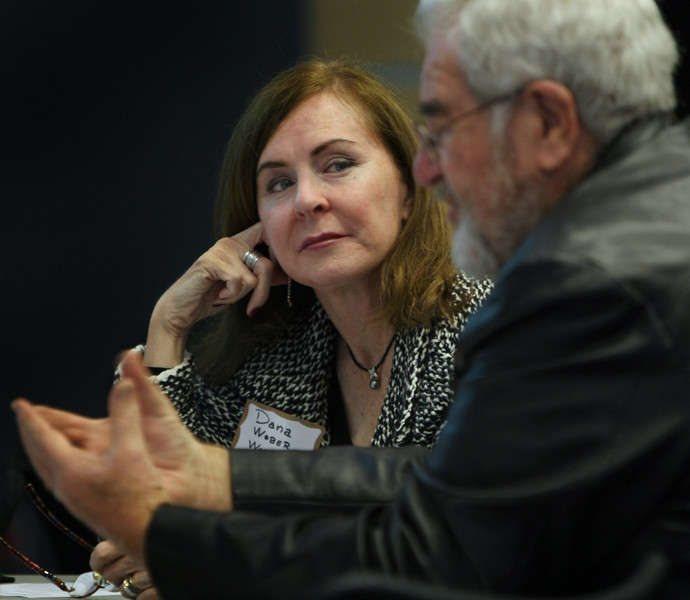 Tulsa Regional STEM Alliance member Dana Weber listens as Bob Strattan speaks during a round table conference at the TCC Center for Creativity.