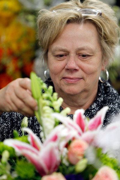 Ranaye Johnston, Owner of Stems flower shop in Tulsa's Utica Square Shopping Center, arranges a flower bouquet.