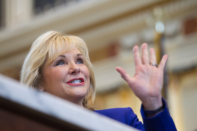 Gov Mary Fallin waves to the gallery before giving the annual State of the State address in the House chamber at the Oklahoma State Capitol.
