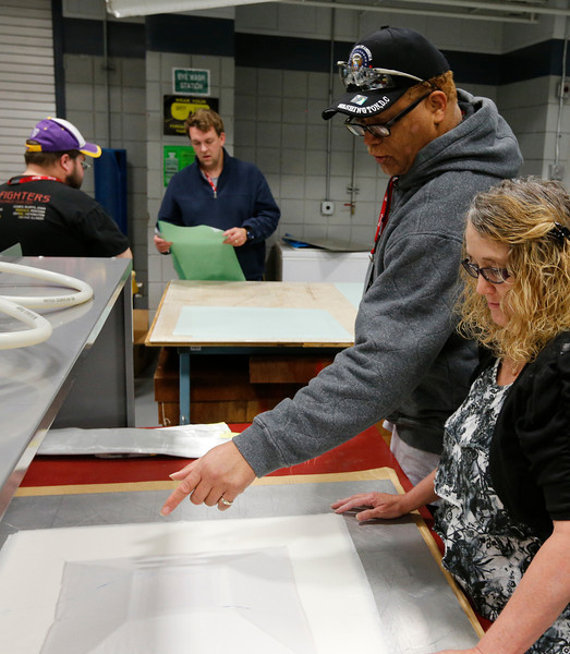 TCC students work to produce a composite aircraft part.
