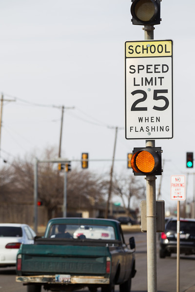 State lawmakers are considering a bill that would make it iligal to use a cell phone while driving through a school zone.