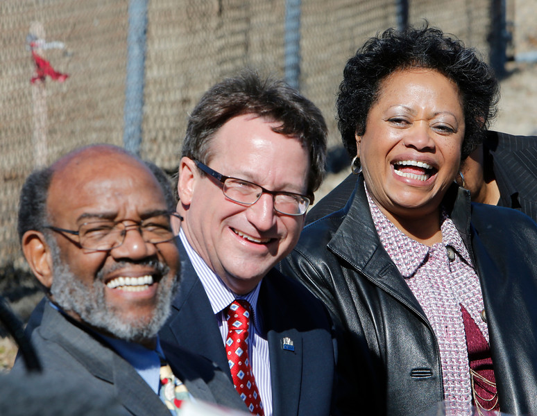 Everyone is all smiles at the Urban 8 Groundbreaking in downtown Tulsa Friday.